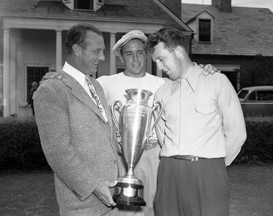 FILE - In this Aug. 21, 1941 file photo, golfer Ray Billows, right, winner of the first Great Lakes amateur golf championship, receives the tournament trophy from Scotty Fessenden, left, president of the Chicago District Golf Association, as Frank Stranahan, center, looks on. Stranahan, a runner-up at two majors as an amateur and a fitness fanatic before it became vogue in golf, died Sunday, June 23, 2013. He was 90. (AP Photo)