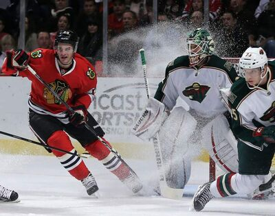 Blackhawks' Brandon Saad sprays Minnesota Wild goalie Niklas  Backstrom March 5 in Chicago.