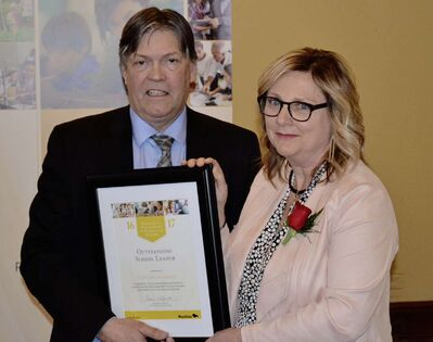 Elaine Giasson (right) principal of École Dieppe was named outstanding school leader by the province. She is pictured with Education and Training Minister Ian Wishart.