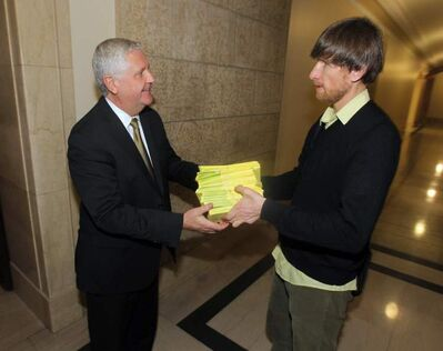 Wilderness Committee Campaign Director Eric Reder, right, gives more than 830 letters to Conservation Minister Gord Mackintosh.