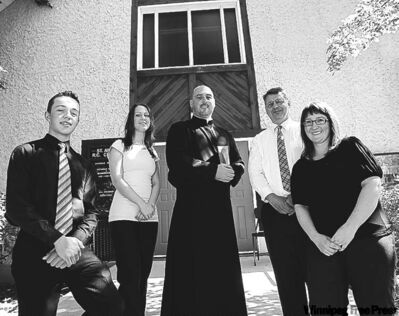 Rev. Jeffrey Burwell (centre) with Anselm Ragelti (from left) Kateri Muys, John Cortens and Dympna Issigonis outside St. Ann's.