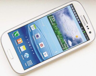 Samsung's new Galaxy S III phone is shown in New York on June 19, 2012. For many consumers wondering whether to consider buying Samsung's latest flagship smartphone, the Galaxy S III, there's really only one question to be answered: is it an iPhone killer? Or, perhaps more fairly, does it stack up against Apple's popular iPhone 4S? THE CANADIAN PRESS/AP - Bebeto Matthews