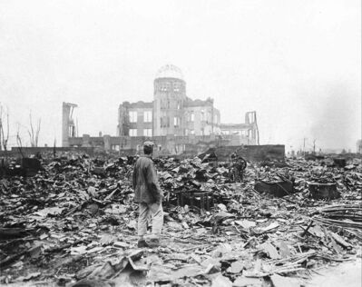 In this Sept. 8, 1945 file photo, an allied correspondent stands in the rubble in Hiroshima a month after the U.S. dropped the first atomic bomb ever on Aug. 6, 1945.