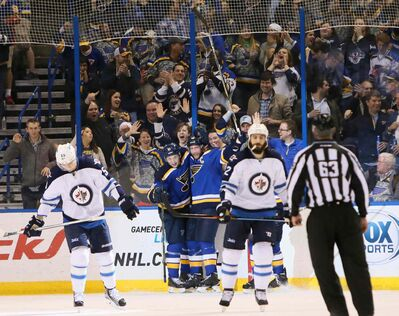 St. Louis Blues right wing Vladimir Tarasenko and center David Backes, center, celebrate after Backes scored during second period action on Monday.