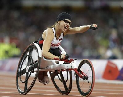 Canada's Michelle Stilwell celebrates after winning the women's 200m T52 final race at the 2012 Paralympics in London, Saturday, Sept. 1, 2012. (AP Photo/Lefteris Pitarakis)