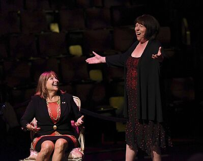 SUPPLIED</p><p>Gail Asper (left) watches Wednesday as actress Nora McClellan performs a modified version of the song As We Stumble Along from The Drowsy Chaperone.</p>