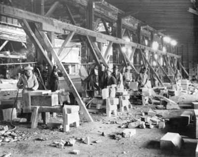 GILLIS QUARRIES LIMITED ARCHIVES</p><p>Workers process Tyndall Stone in the 1930s.</p>