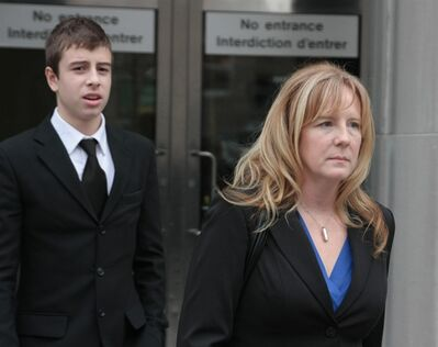 Patricia Hung, the mother of 14-year-old murder victim Stefanie Rengel, leaves court in Toronto with her son Ian on Thursday, Dec. 22, 2011, after the teen convicted in the killing was denied her bid to remain in a youth detention facility. THE CANADIAN PRESS/Colin Perkel