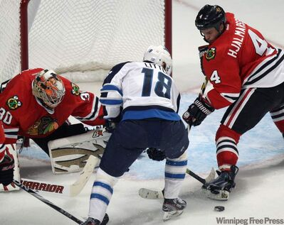 Blackhawks goaltender Ray Emery stymies Winnipeg Jet Bryan Little on Thursday night in Chicago during a 4-3 Jets loss.