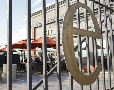 Patrons enjoy a sunny evening on the Earls patio Thursday. The Pembina Highway restaurant will close down next week.