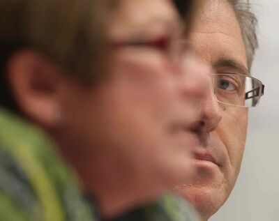 Gord Steeves (right) eyes rival Judy Wasylycia-Leis at the Assiniboia Chamber of Commerce debate.