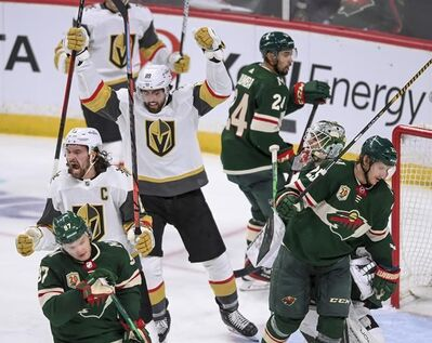 Vegas Golden Knights right wing Mark Stone (61) celebrates after scoring against the Minnesota Wild during the second period in Game 3 of an NHL hockey Stanley Cup first-round playoff series Thursday, May 20, 2021, in St. Paul, Minn. (Aaron Lavinsky/Star Tribune via AP)