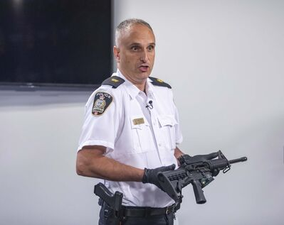 SASHA SEFTER / WINNIPEG FREE PRESS FILES</p><p>Winnipeg Police Inspector Max Waddell displays a recently-seized assault rifle at Police Headquarters in July.</p>