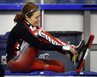 Clara Hughes removes her skates after winning the women's 3000-metre event at the Canadian Speed Skating Single Distance Championships in December.