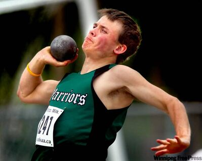 Gladstone's Leighton Peters gives it his all Friday in the shot put. The running events in tetrathlon go today.