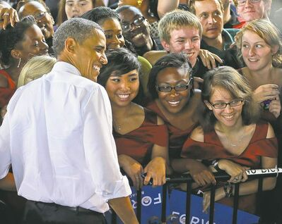 U.S. President Barack Obama stops for a photo with members of the Vox Harmonia Visual and Performing Arts Academy Salem High School at a campaign event in Virginia Beach, Va.