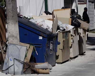 KEN GIGLIOTTI / FREE PRESS FILES</p><p>The city launched a two-year pilot program to curb illegal dumping of garbage in back lanes.</p>