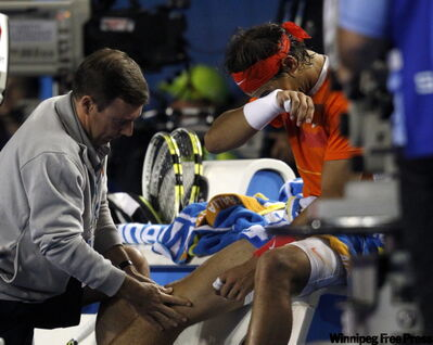 Rafael Nadal receives medical treatment during match with Andy Murray during their men's singles quarter-final match.