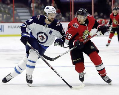 Ottawa Senators right wing Connor Brown and Winnipeg Jets defenceman Josh Morrissey battle for position during the second period.