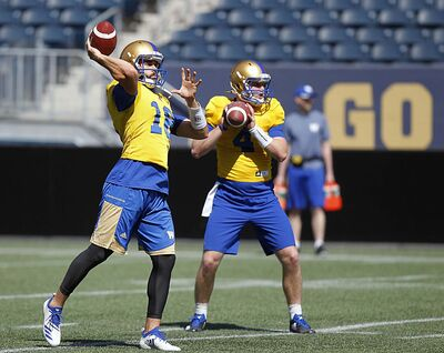 PHIL HOSSACK / WINNIPEG FREE PRESS</p><p>Winnipeg Blue Bomber quarterbacks Alex Ross, left and Zack Mahoney throw passes at a team workout Wednesday.</p>