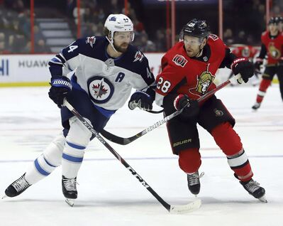 THE CANADIAN PRESS/Fred Chartrand</p><p>Winnipeg Jets defenceman Josh Morrissey, left, was a full participant in Monday's practice and that's good news for a tattered Jets defensive corps.</p>