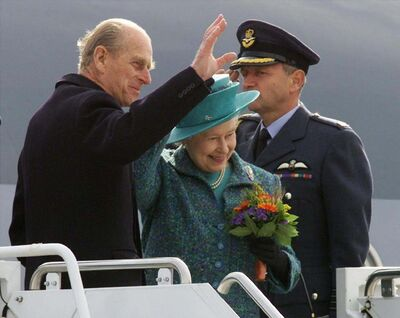The Queen and Prince Philip wave as they depart Winnipeg on Oct. 9, 2002. Prince Philip, the Queen's husband of more than 70 years, passed away at Windsor Castle on Friday, Buckingham Palace announced. (Adrian Wyld / The Canadian Press files)</p>