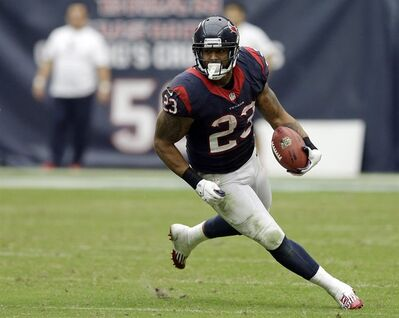 FILE - In this Sept. 29, 2013, file photo, Houston Texans running back Arian Foster (23) rushes for a gain against the Seattle Seahawks during the third quarter an NFL football game in Houston. Here's a new twist on fantasy sports: a San Francisco startup is offering fans a chance to bet on the moneymaking potential of star athletes. The unorthodox and risky investment opportunity kicked off Thursday, Oct. 17, 2013, with an IPO filing proposing to sell stock for a stake in the future income of Foster, one of the best running backs in the NFL. (AP Photo/David J. Phillip, File)