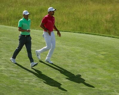 Rory Mcilroy, of Ireland, and Jason Day, of Australia, walk on the eighth hole during the first round of the U.S. Open golf tournament Thursday, June 15, 2017, at Erin Hills in Erin, Wis. (AP Photo/Charlie Riedel)