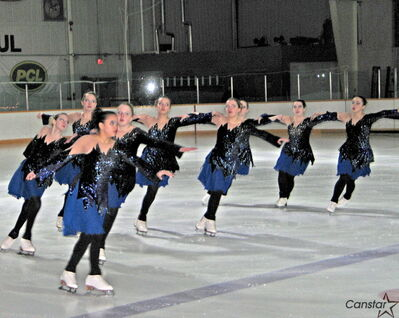 The Ice Illusions synchronized skating team performs at an ice show at East St. Paul Arena on March 22.