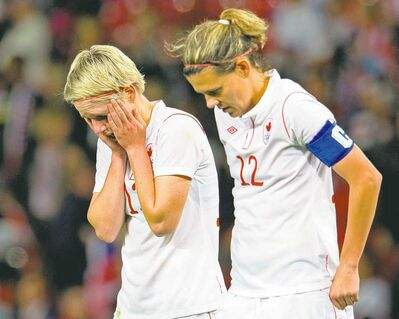 frank gunn / the canadian pressCanadian forwards Christine Sinclair (12) and Sophie Schmidt are shellshocked after the final whistle on Monday.