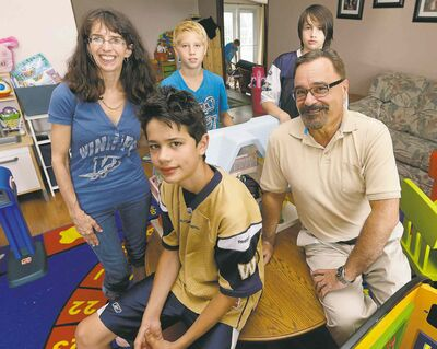 Marni Yakubec with her sons (from left) Thomas, 14, Tye, 11, and Todd, 13  and Jerry Maslowsky of Variety, the Children's Charity.