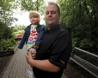 <p>Devin Newton holds daughter, Hailey, 2. She had a spot in preschool in September, but the province has stopped funding.</p>