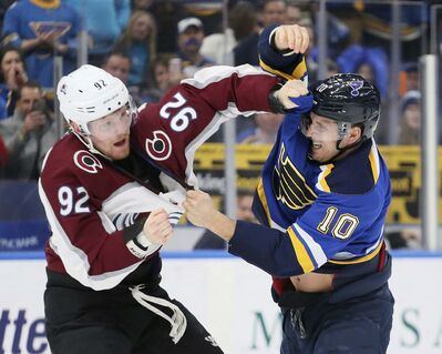 Colorado Avalanche left wing Gabriel Landeskog, left, fights with St. Louis Blues center Brayden Schenn early in the first period Thursday in St. Louis. (Chris Lee / St. Louis Post-Dispatch)</p>
