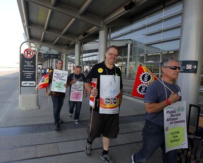 BORIS MINKEVICH / WINNIPEG FREE PRESS A court has placed restrictions on where picketers can walk and how many can picket at one time.