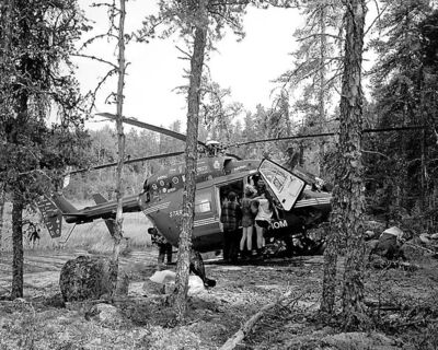 The STARS helicopter takes on its passenger after landing on difficult terrain.