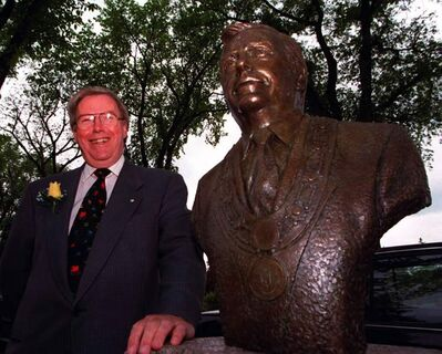 In this photo from 1998, Former mayor Bill Norrie stands beside his bronze double, dedicated at the Citizens' Hall of Fame at Assiniboine Park.