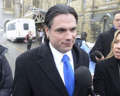 Sen. Patrick Brazeau talks to media on Parliament Hill in Ottawa, Tuesday, Feb.12, 2013.