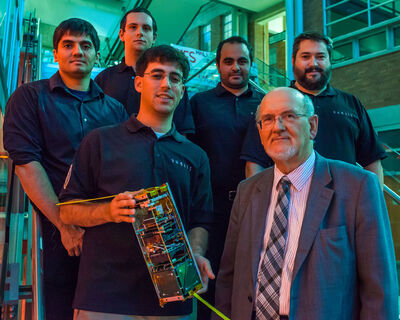 From left:  Ahmad Byagowi, Pawel Glowacki, Dario Schor, Reza Fazel-Darbandi, Prof. Witold Kinsner, and Greg Linton with the scientific research satellite at the University of Manitoba.