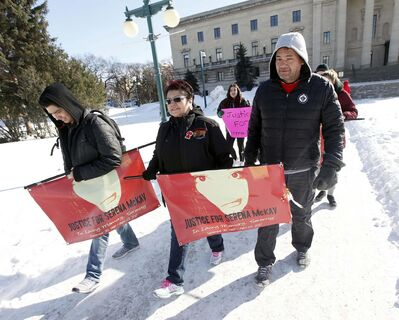 A couple of dozen marchers, including Serena McKay's mother, Delores Daniels (centre), marched from the Legislature Saturday. (Phil Hossack / Winnipeg Free Press)</p>