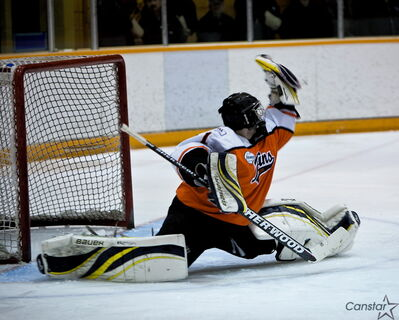 Fort Garry/Fort Rouge Twins goalie Charlie Pogue makes a glove save.