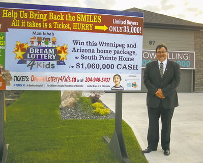 Charles LaFlèche, president and CEO of the St. Boniface Hospital Foundation, stands outside 87 Tascona Rd., part of one of the grand prize selections in the Dream Lottery 4 Kids.