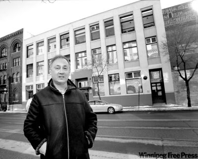 WAYNE GLOWACKI / WINNIPEG FREE PRESS   Developer Hart Mallin in front of his building at 89 Princess St., which he converted into residential and commercial condos.