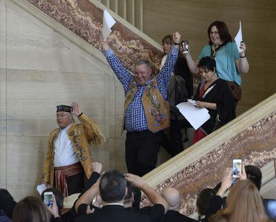 SEAN KILPATRICK / THE CANADIAN PRESS</p><p>Métis National Council President Clement Chartier, left, and David Chartrand, president of the Manitoba Metis Federation, middle, celebrate following a decision at the Supreme Court of Canada in Ottawa on Thursday.</p>