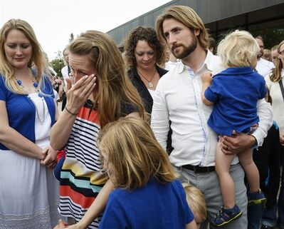Collet Stephan, second from left, wipes away a tear as she and her husband David Stephan arrive at the courthouse with their children in Lethbridge, Alta., Friday, June 24, 2016.THE CANADIAN PRESS/Jeff McIntosh