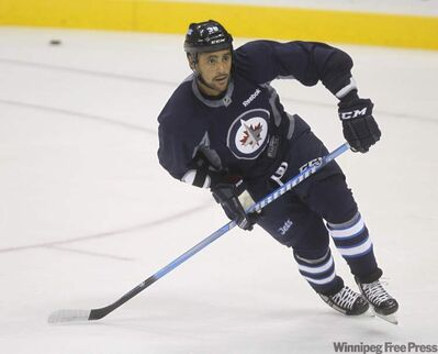 Dustin Byfuglien during practice at MTS Centre on Oct. 8.