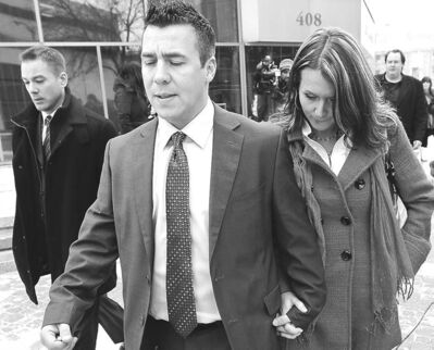 Todd Holt and his girlfriend leave court Wednesday.