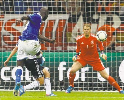 Frank Augstein / THE ASSOCIATED PRESSItaly�s Mario Balotelli scores his second goal during a semifinal win over Germany.