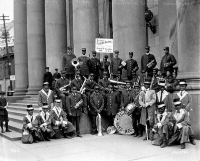 The CNR railway porters' band outside of the Bank of Montreal at Portage and Main in 1922. The iconic bank building is now part  of MTS Place.
