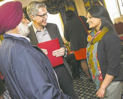 Liberal Leader Rana Bokhari mingles with delegates Mohinder Dhillon (left) and Robert Vineberg at the party's annual general meeting Friday evening.