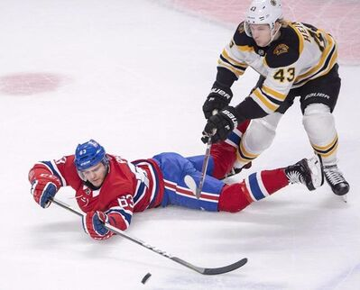 Montreal Canadiens centre Matthew Peca (63) battles Boston Bruins centre Danton Heinen (43) for a loose puck during first period NHL hockey action in Montreal, Monday, Dec. 17, 2018. Peca will be out for approximately six weeks with a knee injury, the NHL team announced Thursday. THE CANADIAN PRESS/Ryan Remiorz
